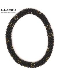 OZOM by Barrucci Roll-On Bracelet Black/Gold Flowers -